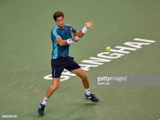 Aljaz Bedene of Great Britain returns a shot to Alexander Zverev of Germany in their Men's Single match during Round 2 of 2017 ATP Shanghai Rolex...