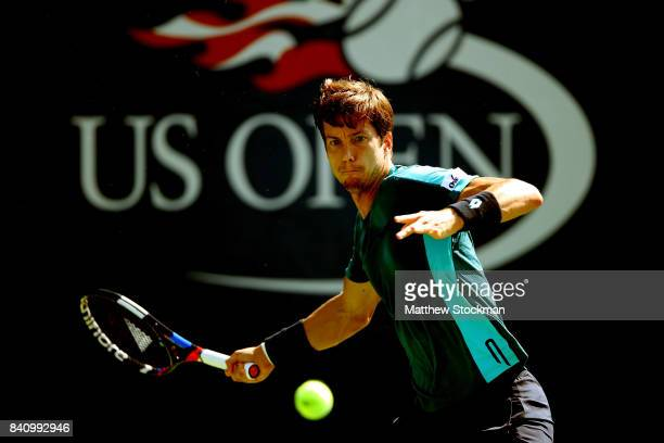 Aljaz Bedene of Great Britain returns a shot to Andrey Rublev of Russia during their first round Men's Singles match on Day Three of the 2017 US Open...