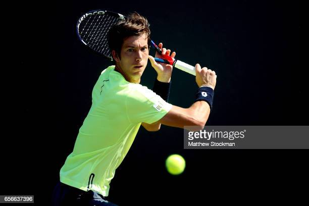 Aljaz Bedene of Great Britain returns ashot to JanLennard Struff of Germany during the Miami Open at the Crandon Park Tennis Center on March 22 2017...