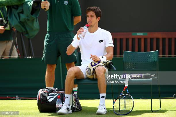 Aljaz Bedene of Great Britain takes a break during the Gentlemen's Singles third round match against Gilles Muller of Luxembourg on day five of the...