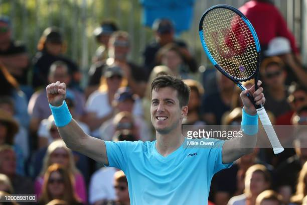 Aljaz Bedene of Slovenia celebrates after winning match point during his Men's Singles first round match against James Duckworth of Australia on day...