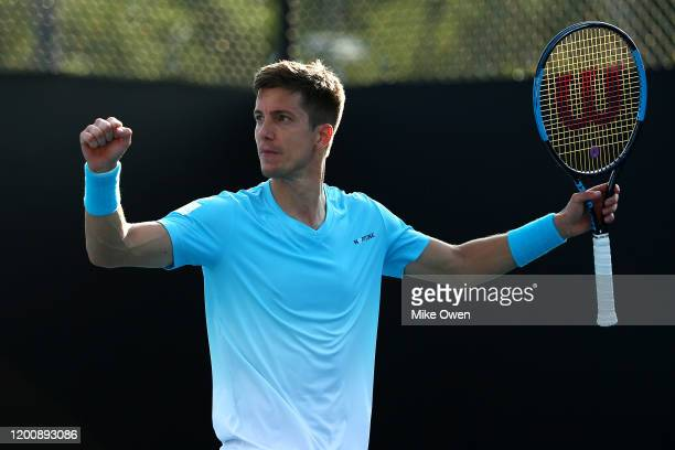 Aljaz Bedene of Slovenia celebrates winning match point during his Men's Singles first round match against James Duckworth of Australia on day two of...