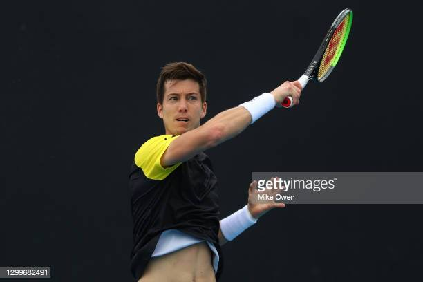 Aljaz Bedene of Slovenia plays a backhand in his match against Yasukata Uchiyama of Japan during day one of the ATP 250 Great Ocean Road Open at...