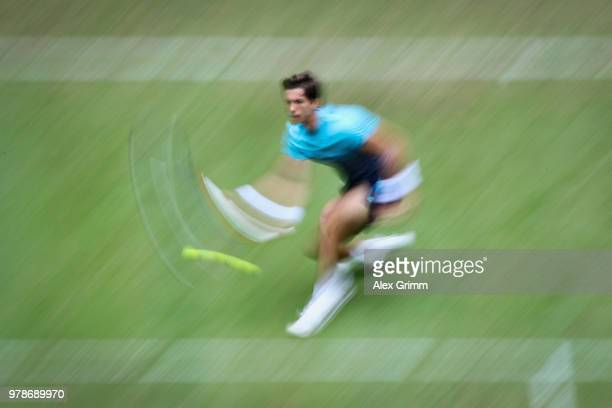 Aljaz Bedene of Slovenia plays a volley to Roger Federer of Switzerland during their first round match on day 2 of the Gerry Weber Open at Gerry...