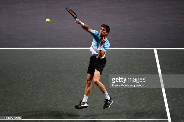 Aljaz Bedene of Slovenia returns a overhead smash against Felix Auger Aliassime of Canada during Day 7 of the ABN AMRO World Tennis Tournament at...