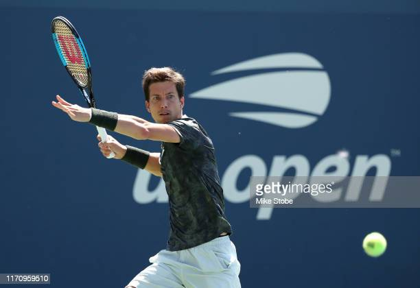 Aljaz Bedene of Slovenia returns a shot during his Men's Singles second round match against Benoit Paire of France on day four of the 2019 US Open at...