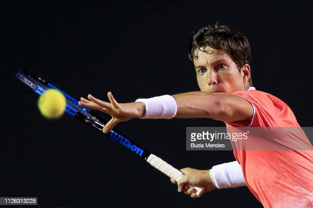 Aljaz Bedene of Slovenia returns a shot to Thiago Monteiro of Brazil during the ATP Rio Open 2019 at Jockey Club Brasileiro on February 20 2019 in...