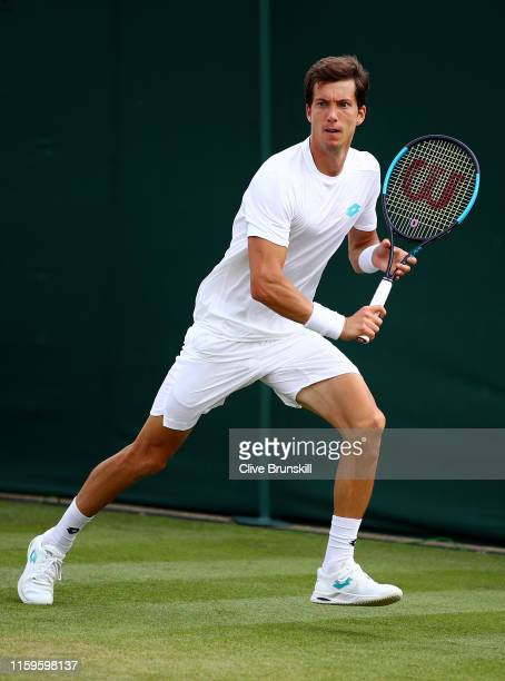 Aljaz Bedene of Slovenia runs to play a backhand in his Men's Singles first round match against Matteo Berrettini of Italy during Day two of The...
