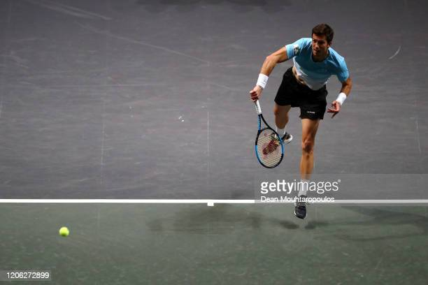 Aljaz Bedene of Slovenia serves against Felix Auger Aliassime of Canada during Day 7 of the ABN AMRO World Tennis Tournament at Rotterdam Ahoy on...
