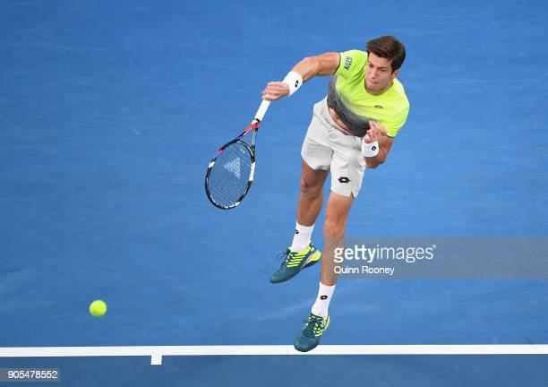 Aljaz Bedene of Slovenia serves in his first round match against Roger Federer of Switzerland on day two of the 2018 Australian Open at Melbourne...