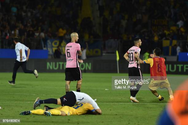 Aljaz Struna and Ilija Nestorovski of Palermo show their dejection as players of Frosinone celebrate after winning the serie B playoff match final...