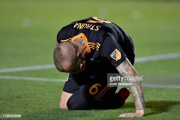 Aljaz Struna of Houston Dynamo lies on the ground during the match between Tigres UANL and Houston Dynamo as part of the CONCACAF Champions League at...