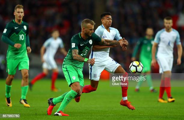 Aljaz Struna of Slovenia and Jesse Lingard of England battle for the ball during the FIFA 2018 World Cup Group F Qualifier between England and...