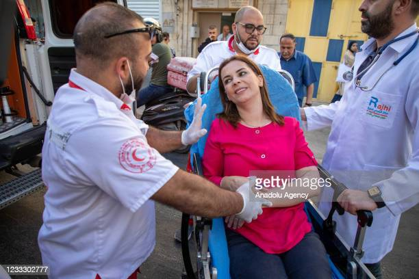 Al-Jazeera correspondent Najwan Simri being carried to an ambulance as she was injured during a protest after Israeli police detained 23 year-old...