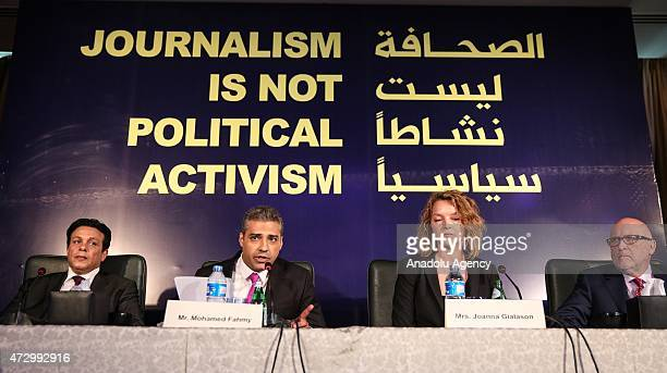 AlJazeera English's CanadianEgyptian journalist Mohammed Fahmy speaks during a press conference with his lawyer Joanna Gialason in Cairo Egypt on May...