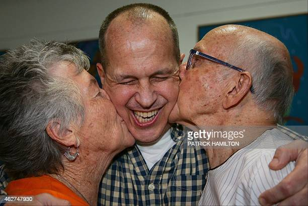 AlJazeera journalist Peter Greste is kissed by his mother Lois and father Juris upon his arrival at Brisbane's international airport in the early...