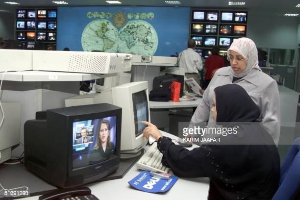 AlJazeera staff work at the satellite channel's headquarters in the Qatari capital Doha 14 October 2001 AlJazeera fighting off charges of...