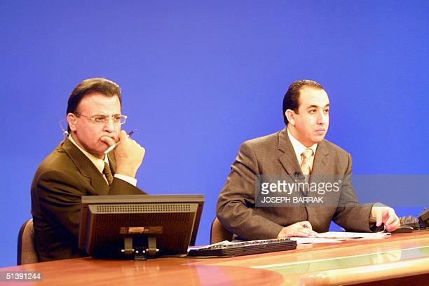 AlJazeera's news speakers Abdel Samad Nasser and Jamal Rayan are seen at the studios of the Qatari satellite network's headquarters in Doha 10...