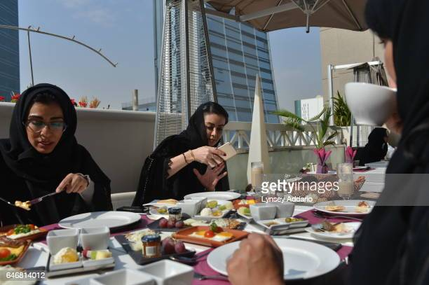 Aljazi Alrakan a dentist and selfdescribed lifestyle blogger joins friends for brunch at a fashionable restaurant in Riyadh Saudi Arabia December 2...