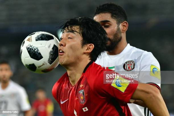 AlJazira's Emirati defender Salem Rashid Obaid vies for the ball against Urawa Reds' Japanese defender Wataru Endo during their FIFA Club World Cup...