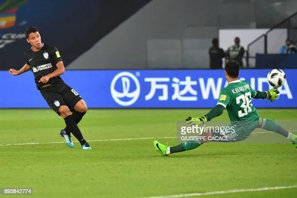 AlJazira's Emirati goalkeeper Khaled alSenaani fails to save a shot on goal by CF Pachuca's Mexican forward Roberto De La Rosa during the thirdplace...