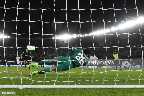 AlJazira's goalkeeper Khaled alSenaani fails to save a penalty kicked by CF Pachuca's Chilean forward Angelo Sagal during the thirdplace playoff...