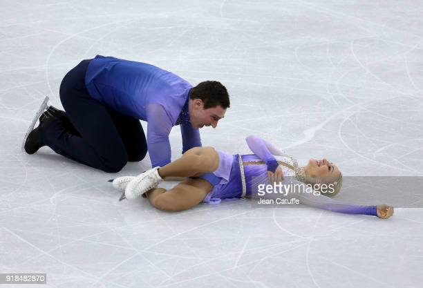 Aljona Savchenko and Bruno Massot of Germany react after their performance during the Figure Skating Pair Skating Free Program on day six of the...