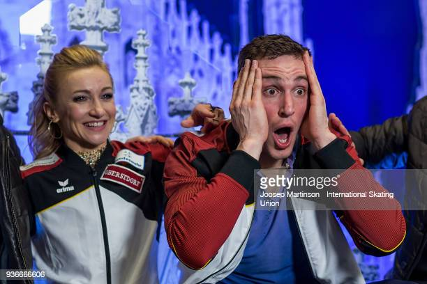 Aljona Savchenko and Bruno Massot of Germany react at the kiss and cry after competing in the Pairs Free Skating during day two of the World Figure...