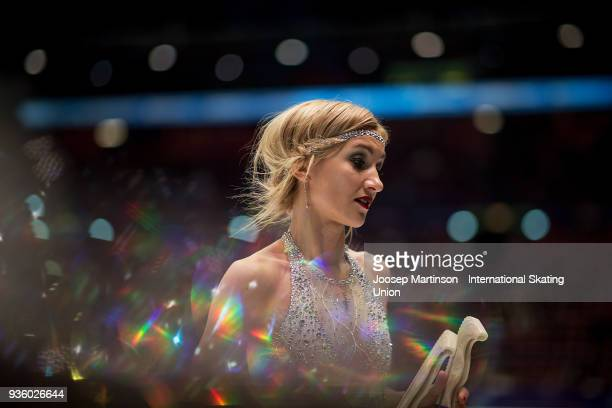 Aljona Savchenko of Germany prepares in the Pairs Short Program during day one of the World Figure Skating Championships at Mediolanum Forum on March...
