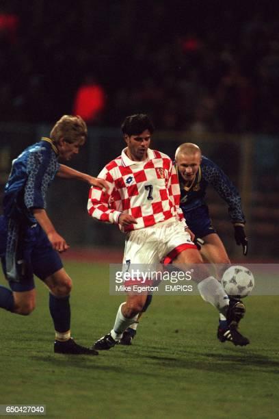 Aljosa Asanovic of Croatia controls the ball