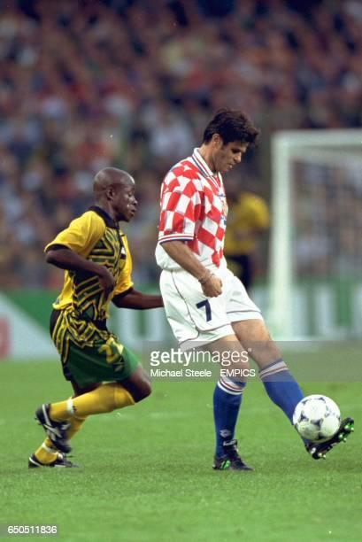 Aljosa Asanovic of Croatia gets the ball away from Paul Hall of Jamaica