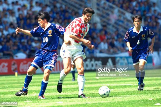 Aljosa Asanovic of Croatia is fouled by Japan's Hiroshi Nanami