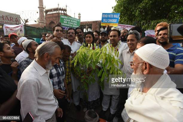 Alka Lamba and Asim Ahmed Khan along with others plant saplings after the antiencroachment drive at Jama Masjid on May 3 2018 in New Delhi India A...