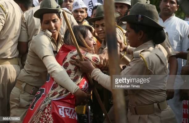 Alka Lamba and supporters court arrest as they were stopped by police officials from marching towards CM residence to submit a memorandum during a...