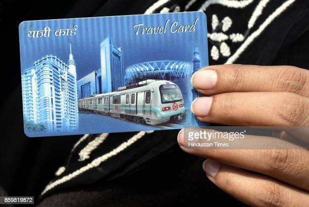 Alka Lamba shows her metro card when she arrived for attending the special session of the Legislative Assembly of National Capital Territory of Delhi...
