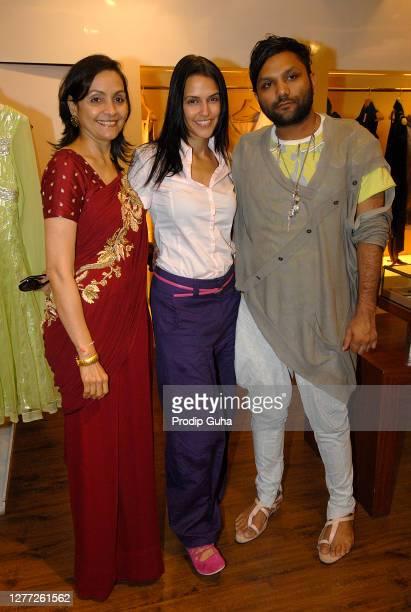 Alka Nisharand Neha Dhupia attend the Gaurav Gupta's fashion collection at AZA on July 29, 2010 in Mumbai, India