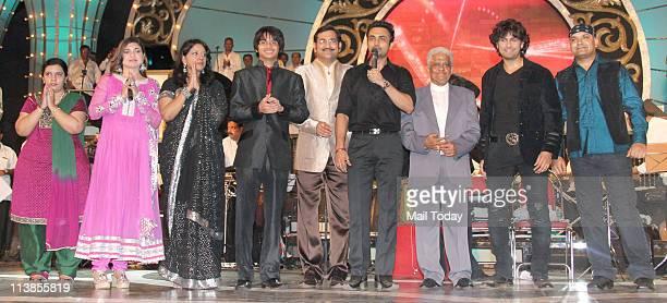 Alka Yagnik Kavita Krishnamurthy Siddharth Sudesh Bhosle Pyarelal and Sonu Nigam during Pyarelal's musical concert at Andheri Sports Complex in Mumbai