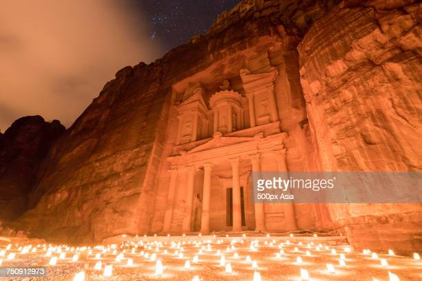 """""""al-khazneh building of ancient city of petra at night, maan governorate, jordan"""" - image stock pictures, royalty-free photos & images"""