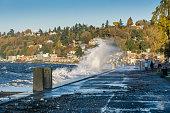 waves crash onto shore at alki