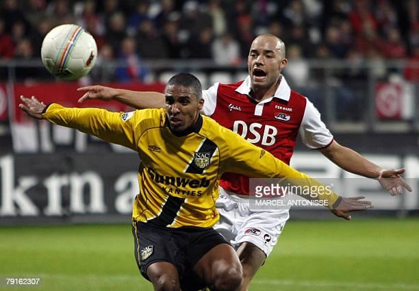 AZ Alkmaar football player Demy de Zeeuw fights for the ball with Patrick Mtiliga of NAC Breda 22 January 2008 during the Dutch Premier League match...