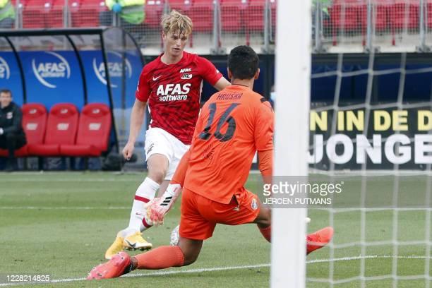 Alkmaar Icelandic forward Albert Gudmundsson scores a goal against FC Viktoria Plzen's Czech goalkeeper Ales Hruska during the second qualifying...