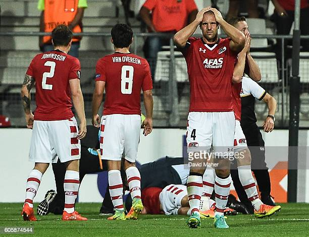Alkmaar Netherlands 15 September 2016 AZ Alkmaar players react as Stijn Wuytens of AZ Alkmaar lies injured after scoring his side's first goal during...