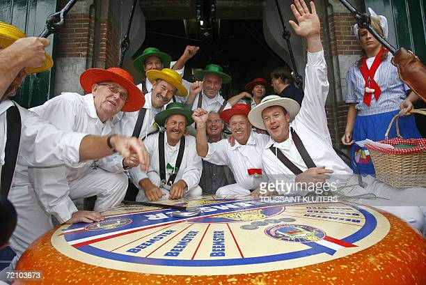 People celebrate in front the biggest cheese ever made in Alkmaar the Netherlands 06 September 2006 The cheese got an introduction in the Guinness...