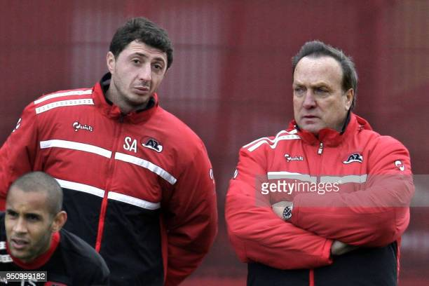 AZ Alkmaar trainer Dick Advocaat talks with assistant trainer Shota Arveladze during the training of AZ in Alkmaar on December 10 2009 AZ trained for...