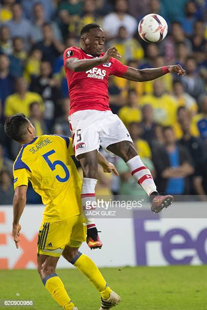 Alkmaar's Dutch defender Ridgeciano Haps vies with Maccabi's Argentinian forward Ezequiel Scarione during their UEFA Europa League football match...