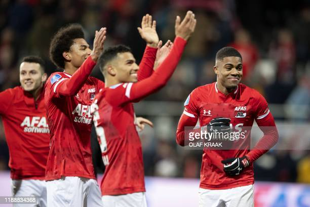 Alkmaar's Dutch forward Myron Boadu celebrates with teammates their 10 victory over Ajax during the Dutch Premier League football match between AZ...