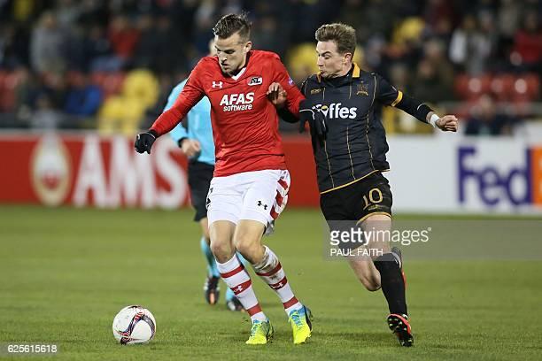 AZ Alkmaar's Dutch midfielder Mats Seuntjens tries to hold off Dundalk's Irish midfielder Ronan Finn during the UEFA Europa League group D football...