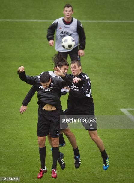 AZ Alkmaar's players Dutch Maarten Martens Dutch Etienne Reijnen Finnish Niklas Moisander and Dutch Erik Falkenburg attend a training session on...