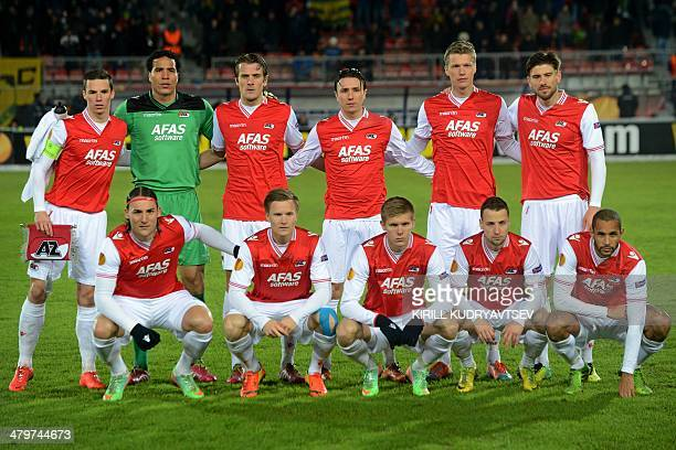 AZ Alkmaar's players pose before UEFA Europa League round of 16 football match between FC Anzhi Makhachkala and AZ Alkmaar in Ramenskoye outside...