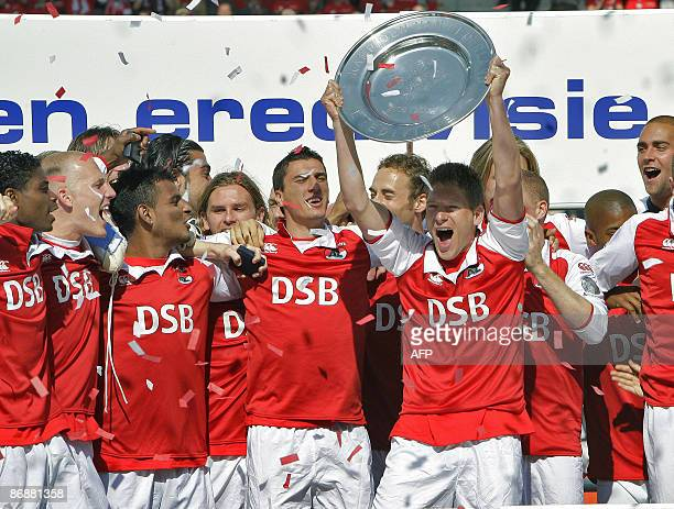 AZ Alkmaar's Stijn Schaars holds the champion plate as they are Champions of the Netherlands on May 10 2009 after their Dutch league football match...